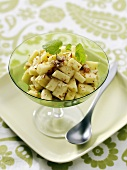 Apple salad with maple syrup and hazelnuts