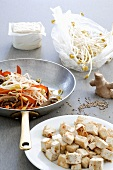 Asian vegetable stir-fry with sprouts and tofu