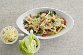 Pasta with spring onions, tomatoes and cheese