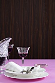 Elegant white tableware, fabric napkin and red wine
