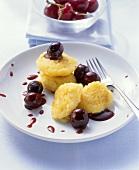 Polenta cakes with sour cherries