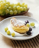 Sweet soufflé omelette with grapes and quince cream