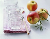Preserving jars and fresh apples