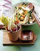 Raw vegetables with olive oil dip and vegetable salad
