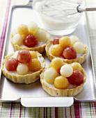 Melon tarts with melon balls and yoghurt cream
