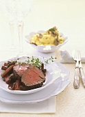 Beef fillet with carrots and mushrooms in red wine sauce