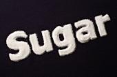 The word 'Sugar' written in sugar