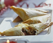 Filo pastries filled with feta cheese and red onions