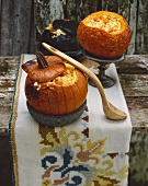 Pumpkin risotto served in hollowed-out pumpkins