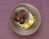 Sturgeon fillet on shredded leek with beetroot