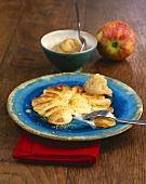 Pan-cooked potato & cheese dish with apple & onion puree