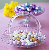 Easter sweets: small coloured Eastered eggs in glass dish