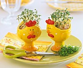 Easter decoration: cress in amusing eggcups