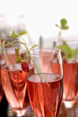 Glasses of strawberry Sekt (sparkling wine with strawberry syrup)