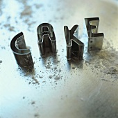 Cutters spelling the word 'Cake'