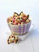 Multicoloured bow-tie pasta (farfalle) in a small bowl