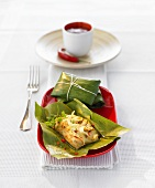 Pangasius fillet steamed in a banana leaf, Thai style