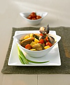 Red duck curry with pineapple and cherry tomatoes