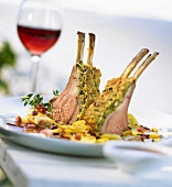 Rack of lamb in herb crust with fried potatoes & a glass of wine