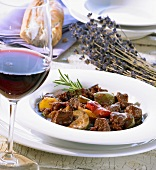 Provençal lamb ragout and a glass of red wine