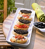 Assorted crostini on an appetiser platter