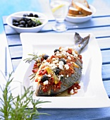 A whole sea bream cooked Greek style