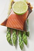Vacuum-packed, marinated salmon fillet on asparagus