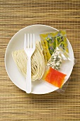 Asian instant noodles with spice mixture and fork on plate