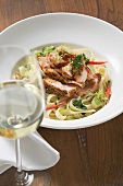 Ribbon pasta with fried peppered salmon, red pepper & wine