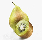 Pear with drops of water and half a kiwi fruit