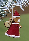 Gingerbread Father Christmas hanging on a fir branch