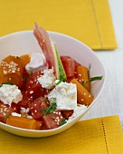 Watermelon and carrot salad with feta and sesame seeds