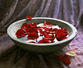 Rose petals in a stone bowl
