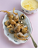 Schlosserbuben (prune fritters) with orange sauce