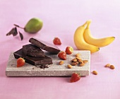 Still life with chocolate, fruit and almonds