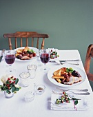 Laid table with plates of roast turkey (Christmas)