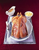 Roast goose with juniper sauce and lemon apple puree