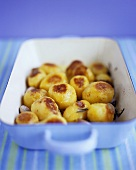 Rosemary roast potatoes in a roasting dish