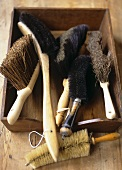 Assorted brushes in a wooden box