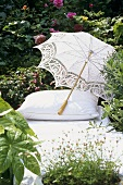 Lounger with parasol in garden