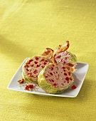 Stuffed savoy cabbage leaves filled with mince, dried tomatoes