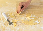Making ravioli with mushroom filling