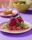 Fried tuna in pepper crust on melon salsa