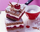 Chocolate sponge slices with cherries and yoghurt cream