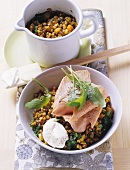 Poached salmon trout fillets on buckwheat & vegetables with rocket