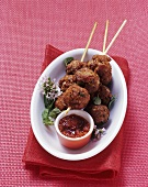 Stuffed meatballs on skewers with tomato chutney
