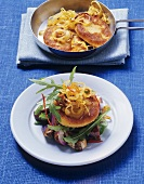 Tofu burgers with onions on rocket and aubergine salad