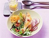 Salmon steak on vegetable salad