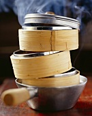 Steaming baskets in a saucepan