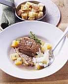 Cooked shoulder of beef with swedes and Parmesan
